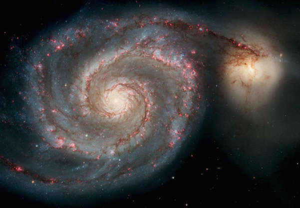 Slide 45 of 86: SPACE - APRIL 25: In this handout image released from the Hubble Space Telescope the Whirlpool Galaxy is seen , April 25, 2005 released for the Hubble 15th anniversary. Nasa's Space Telescope has obited the Earth for 15 years and has taken more than 700,000 images of the comos. This image is one of the sharpest images Hubble has ever produced, taken with the newest camera. (Photo by Hubble Space Telescope/Nasa via Getty Images)