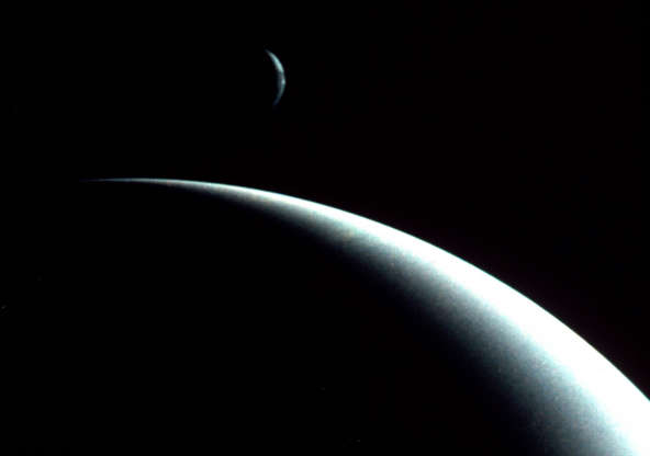Slide 61 of 86: This dramatic view of the crescents of Neptune and Triton was acquired by Voyager II approximately 3 days, 6 and one-half hours after it's closest approach to Neptune (August 29, 1989). (Photo by Photo12/UIG/Getty Images)