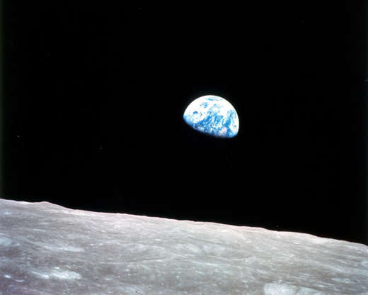 "Slide 70 of 86: Apollo 8, the first manned mission to the moon, entered lunar orbit on Christmas Eve, Dec. 24, 1968. That evening, the astronauts-Commander Frank Borman, Command Module Pilot Jim Lovell, and Lunar Module Pilot William Anders-held a live broadcast from lunar orbit, in which they showed pictures of the Earth and moon as seen from their spacecraft. Said Lovell, ""The vast loneliness is awe-inspiring and it makes you realize just what you have back there on Earth."" They ended the broadcast with the crew taking turns reading from the book of Genesis."