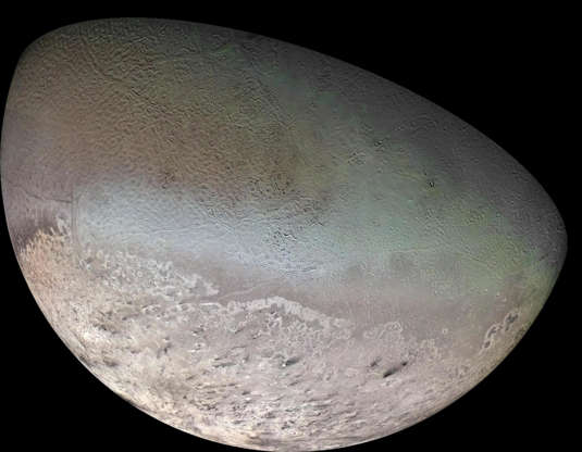 """Slide 62 of 86: Neptune's largest moon Triton, is seen in this mosaic of images captured by Voyager 2 during the only visit thus far to the Neptune system.  Triton is one of only three objects in the Solar System known to have a nitrogen-dominated atmosphere (the others are Earth and Saturn's giant moon, Titan). It has the coldest surface known anywhere in the Solar System (38 K, about -391 degrees Fahrenheit) - so cold that most of Triton's nitrogen is condensed as frost, making it the only satellite in the Solar System known to have a surface made mainly of nitrogen ice.  The dark streaks overlying the pinkish ices at bottom are believed to be dust deposited from huge geyser-like plumes, some of which were found to be active during the Voyager 2 flyby. The bluish-green band visible in this image extends all the way around Triton near the equator; it may consist of relatively fresh nitrogen frost deposits. The greenish areas includes what is called the cantaloupe terrain, whose origin is unknown, and a set of """"cryovolcanic"""" landscapes apparently produced by icy-cold liquids (now frozen) erupted from Triton's interior."""