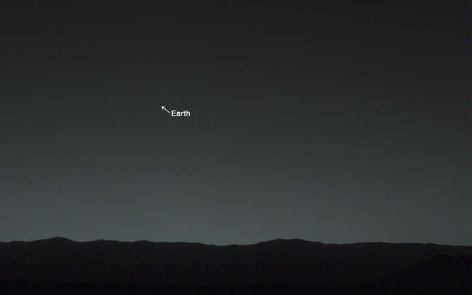 """Slide 74 of 86: A starry twilight sky looms over a nondescript Martian surface. If you had happened to be standing next to the Mars Curiosity rover as it took this picture, you would have seen Earth shining as a distinct """"evening star."""""""