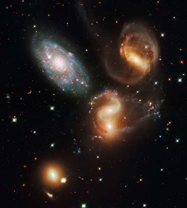 Slide 82 of 86: IN SPACE - JULY/AUGUST 2009: In this composite image provided by NASA, ESA, and the Hubble SM4 ERO Team, Stephan's Quintet (HCG 92) in the Pegasus constellation is pictured in Space. Today, September 9, 2009, NASA released the first images taken with the Hubble Space Telescope since its repair in the spring. (Photo by NASA, ESA, and the Hubble SM4 ERO Team via Getty Images)