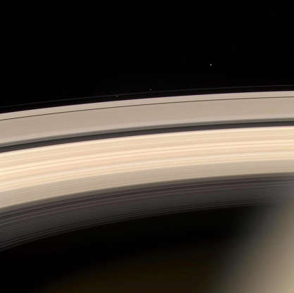 Slide 47 of 86: SPACE, SPACE: Saturn and its rings are prominently shown in this color image released by NASA 19 August, 2004, along with three of Saturn's smaller moons. From L-R they are: Prometheus, Pandora and Janus. Prometheus and Pandora are often called the 'F ring shepherds' as they control and interact with Saturn's interesting F ring, seen between them. This image was taken at a distance of 8.2 million kilometers (5.1 million miles) from Saturn. The Cassini-Huygens mission is a cooperative project of NASA, the European Space Agency and the Italian Space Agency. AFP PHOTO/NASA (Photo credit should read HO/AFP/Getty Images)