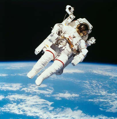 Slide 64 of 86: American astronaut Bruce McCandless II photographed from the Space Shuttle Challenger during the first untethered EVA, made possible by his nitrogen jet propelled backpack (Manned Manuevering Unit or MMU), 7th February 1984. (Photo by NASA/Space Frontiers/Getty Images)