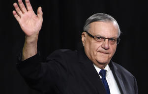 Sheriff Joe Arpaio attends a rally by Republican presidential candidate Donald Trump, October 4, 2016, in Prescott Valley, Arizona. Arpaio will soon face criminal charges from federal prosecutors over his immigration patrols. Federal prosecutors say they will charge Arpaio with contempt-of-court after he allegedly failed to obey a judges order to halt controversial immigration policies that some say include racial profiling.