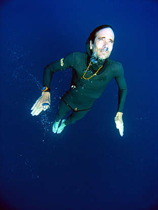 Slide 8 of 28: Dave MullinsThis swimmer from New Zealand can dive 108 meters deep without any equipment. He can also swim 244 meters in four minutes and two seconds.