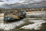 SEASIDE HEIGHTS, NJ - OCTOBER 31: Waves break in front of a destroyed amusement park wrecked by Hurricane Sandy on October 31, 2012 in Seaside Heights, New Jersey. At least 50 people were reportedly killed in the U.S. by Sandy with New Jersey suffering massive damage and power outages. (Photo by Mario Tama/Getty Images)