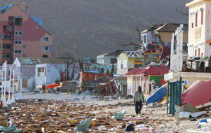 A man walks among the destruction left by Hurricane Irma at the Phillipsburg Town Beach on September 11, 2017 in Philipsburg, St. Maarten.