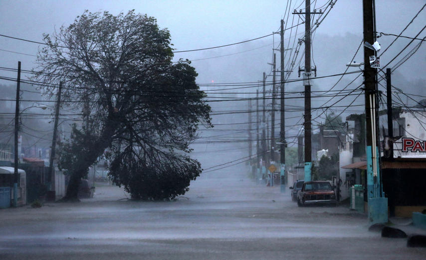 Slide 24 of 31: FAJARDO, PUERTO RICO - SEPTEMBER 06: A street is flooded during the passing of Hurricane Irma on September 6, 2017 in Fajardo, Puerto Rico. The category 5 storm is expected to pass over Puerto Rico and the Virgin Islands today, and make landfall in Florida by the weekend. (Photo by Jose Jimenez/Getty Images)