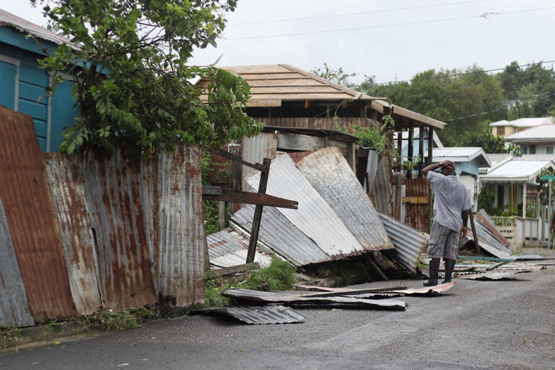 Slide 27 of 31: A man surveys the wreckage on his property after the passing of Hurricane Irma, in St. John's, Antigua and Barbuda, Wednesday, Sept. 6, 2017. Heavy rain and 185-mph winds lashed the Virgin Islands and Puerto Rico's northeast coast as Irma, the strongest Atlantic Ocean hurricane ever measured, roared through Caribbean islands on its way to a possible hit on South Florida. (AP Photo/Johnny Jno-Baptiste)