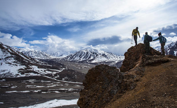 Slide 1 of 12: Doing a ridge walk in Denali national park as a weather system starts to develop in the background.