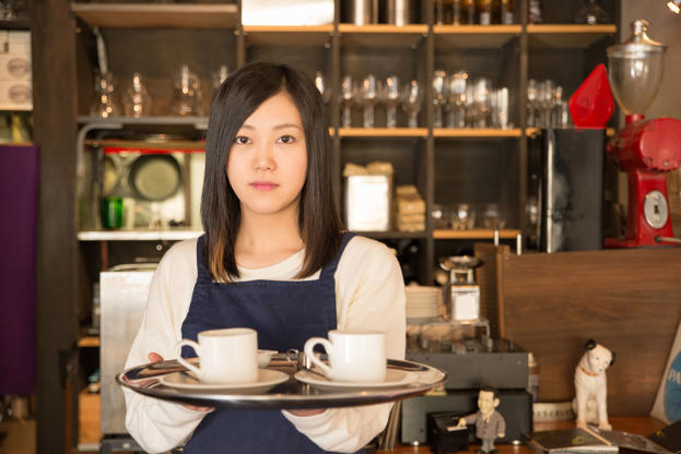 21 枚のスライドの 2 枚目: Young Pretty Waitress is serving coffee at the Japanese cafe restrant in Tokyo