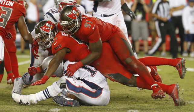 Slide 1 of 23: The Buccaneers' Kendell Beckwith (51) and Robert Ayers (91) combine to sack the Patriots' Tom Brady (12) on Thursday in Tampa, FL. The Patriots won 19-14.