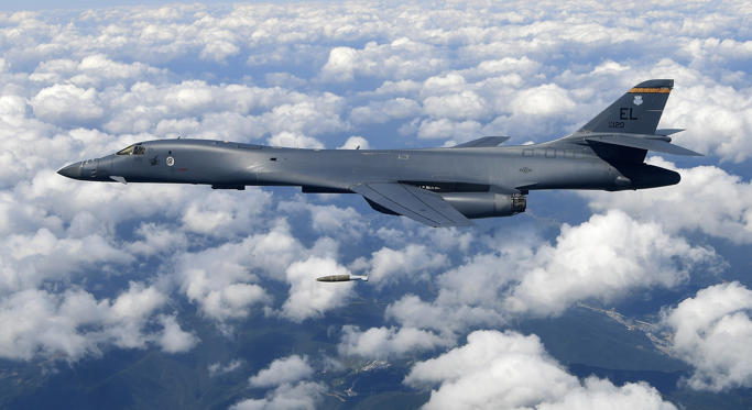 Slide 11 of 79: In this handout image provided by South Korean Defense Ministry, U.S. Air Force B-1B Lancer bomber drop MK-84 bomb during a training at the Pilsung Firing Range on September 18, 2017 in Gangwon-do, South Korea. U.S. F-35B stealth jets and B-1B bombers flew near the Military Demarcation Line (MDL) for the first time since recent tension between U.S. and North Korea started raising.