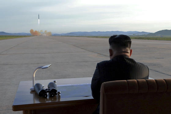 Slide 16 of 79: North Korean leader Kim Jong Un watches the launch of a Hwasong-12 missile in this undated photo released by North Korea's Korean Central News Agency (KCNA) on September 16, 2017.