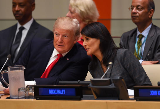Slide 9 of 79: US President Donald Trump and US ambassador to the United Nations Nikki Haley speak during a meeting on United Nations Reform at the United Nations headquarters on September 18, 2017, in New York.