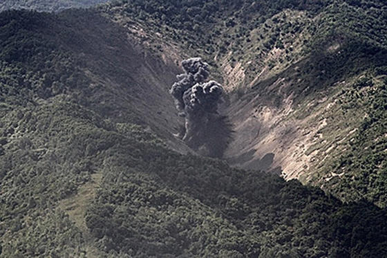 Slide 12 of 79: In this handout image provided by South Korean Defense Ministry, A bomb hits a mock target at the Pilseung Firing Range on September 18, 2017 in Gangwon-do, South Korea. U.S. F-35B stealth jets and B-1B bombers flew near the Military Demarcation Line (MDL) for the first time since recent tension between U.S. and North Korea started raising.