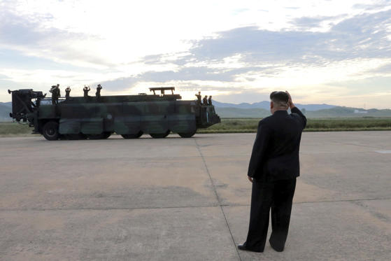 Slide 15 of 79: North Korean leader Kim Jong Un guides the launch of a Hwasong-12 missile in this undated photo released by North Korea's Korean Central News Agency (KCNA) on September 16, 2017.
