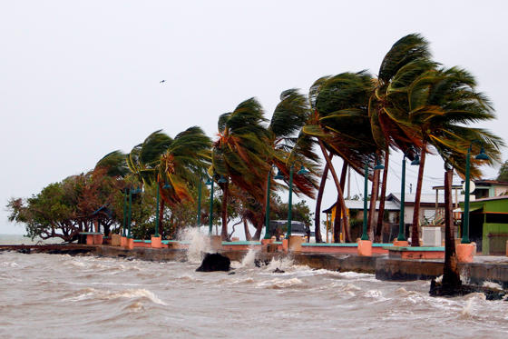 Slide 1 de 34: Winds lash the coastal city of Fajardo as Hurricane Maria approaches Puerto Rico, on September 19, 2017. Maria headed towards the Virgin Islands and Puerto Rico after battering the eastern Caribbean island of Dominica, with the US National Hurricane Center warning of a 'potentially catastrophic' impact. / AFP PHOTO / Ricardo ARDUENGO (Photo credit should read