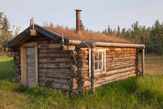 Diapositive 13 sur 28: O antigo centro de troca de mercadorias à beira do Rio Yukon, abandonado na década de 50, já chegou a registrar temperaturas de -58,9 ºC.