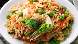 66. Fried rice with chopped up chicken.