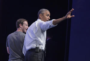 US President Barack Obama waves as he walks off stage with Facebook CEO and founder Mark Zuckerberg after a discussion at the Global Entrepreneurship Summit at Stanford University in Palo Alto, California on June 24, 2016.