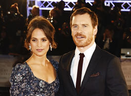 LONDON, ENGLAND - OCTOBER 19: Michael Fassbender (R) and Alicia Vikander attend the UK Premiere of 'The Light Between Oceans' at The Curzon Mayfair on October 19, 2016 in London, England. (Photo by Dave J Hogan/Dave J Hogan/Getty Images)
