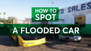 a green and black sign: Flooded Cars: How to Spot One Before You Buy