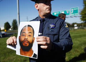 Harford County Sheriff Jeffrey Gahler displays a photo of Radee Labeeb Prince, the suspect in a shooting at a business park in the Edgewood area of Harford County, Md., on Oct. 18, 2017.