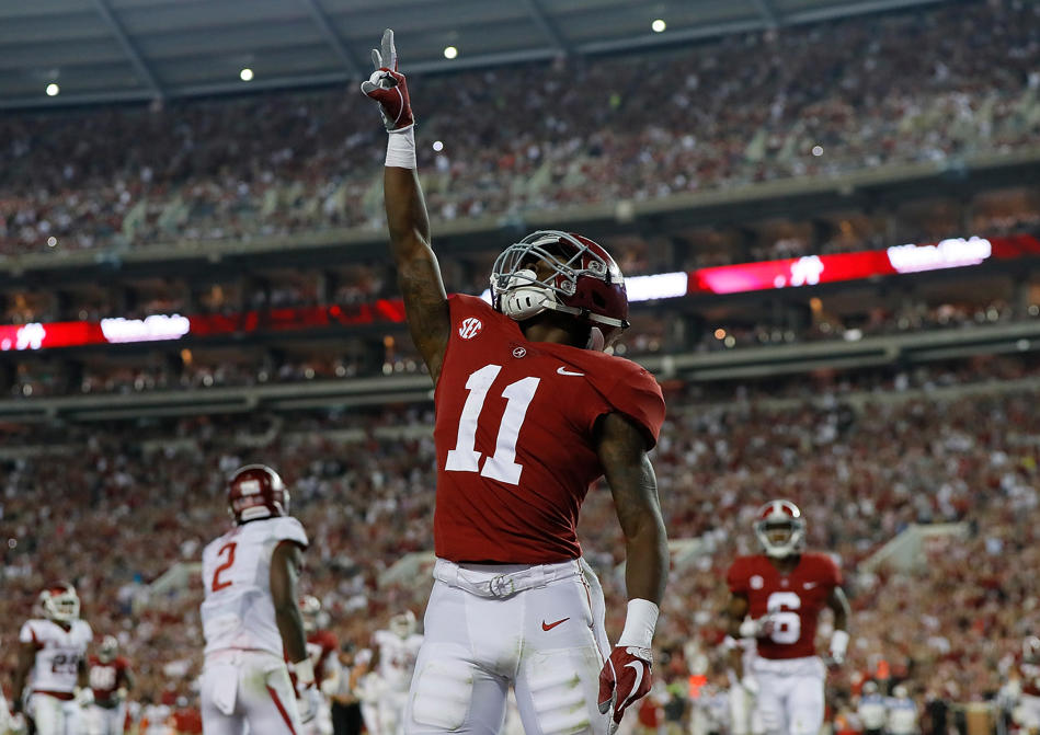 Slide 1 of 21: TUSCALOOSA, AL - OCTOBER 14:  Henry Ruggs III #11 of the Alabama Crimson Tide reacts after pulling in a touchdown reception against the Arkansas Razorbacks at Bryant-Denny Stadium on October 14, 2017 in Tuscaloosa, Alabama.  (Photo by Kevin C. Cox/Getty Images)