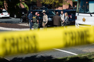 Police stand outside the Harford County Sheriff's Office Incident Command center. A gunman opened fire at an Edgewood Maryland office park on Wednesday morning, October 18, 2017, killing three co-workers and wounding two others.