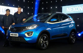 Tata Motors Chief Executive Officer Guenter Butschek, second from left, and Passenger vehicle business unit President Mayank Pareek, stand next to a Tata Nexon during its launch in Mumbai.
