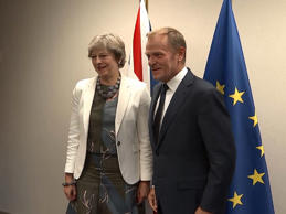 Donald Tusk announced the news minutes before Mrs May's speech