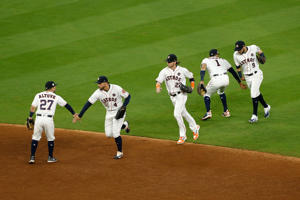 HOUSTON, TX - OCTOBER 20: The Houston Astros celebrate after defeating the New York Yankees with a score of 7 to 1 in Game Six of the American League Championship Series at Minute Maid Park on October 20, 2017 in Houston, Texas.  (Photo by Bob Levey/Getty Images)