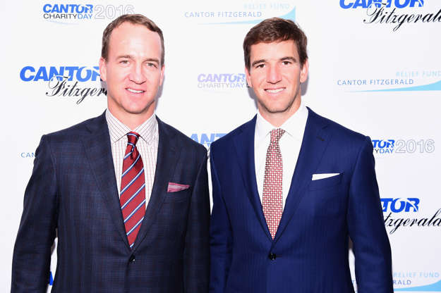 Slide 5 of 55: NEW YORK, NY - SEPTEMBER 12: Former NFL player Peyton Manning and NY Giants, NFL player Eli Manning attend the Annual Charity Day hosted by Cantor Fitzgerald, BGC and GFI at Cantor Fitzgerald on September 12, 2016 in New York City. (Photo by