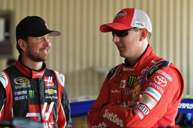 Slide 14 of 55: DOVER, DE - MAY 30: Kurt Busch, driver of the #41 Haas Automation Chevrolet, left, talks with brother Kyle Busch, driver of the #18 Skittles Toyota, in the garage area during practice for the NASCAR Sprint Cup Series FedEx 400 Benefiting Autism Speaks at Dover International Speedway on May 30, 2015 in Dover, Delaware. (Photo by
