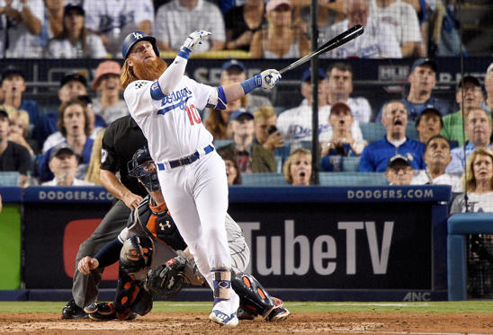 Slide 30 of 39: Justin Turner #10 of the Los Angeles Dodgers hits a two-run home run during the sixth inning against the Houston Astros in game one of the 2017 World Series at Dodger Stadium on October 24, 2017 in Los Angeles, California.