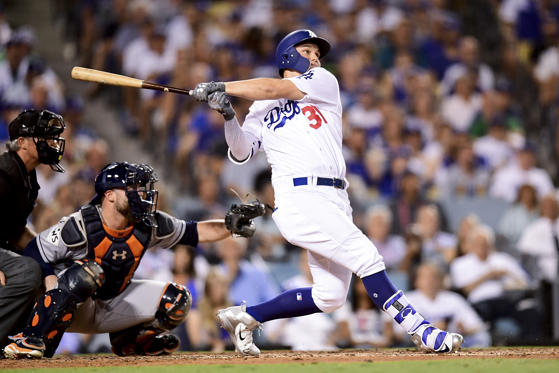 Slide 28 of 39: Joc Pederson of Dodgers hits a solo home run during the fifth inning against Astros in game two of the 2017 World Series on Oct. 25 in Los Angeles, California. Astros won 7-6.