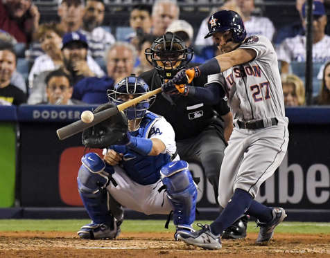 Slide 23 of 39: Astros' Jose Altuve hits a home run against Dodgers during the 10th inning of Game 2 World Series on Oct. 25, in Los Angeles. Astros won 7-6.