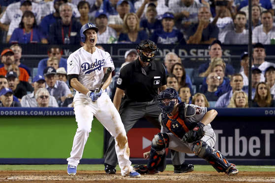 Slide 27 of 39: Corey Seager of Dodgers celebrates after hitting a two-run home run during the sixth inning against Astros in game two of the 2017 World Series on Oct. 25 in Los Angeles, California.