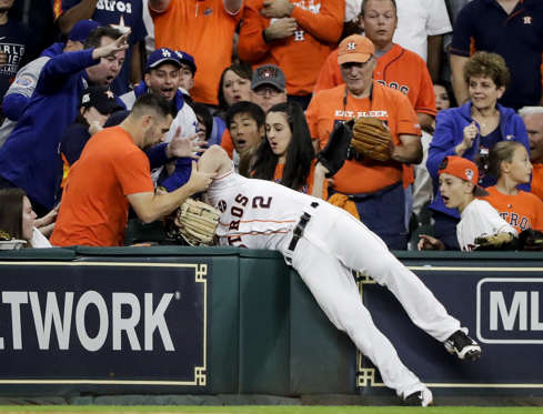 Slide 17 of 39: Astros' Alex Bregman can't catch a foul ball hit by Dodgers' Andre Ethier during the seventh inning of Game 3 of World Series on Oct. 27 in Houston. Houston won 5-3.