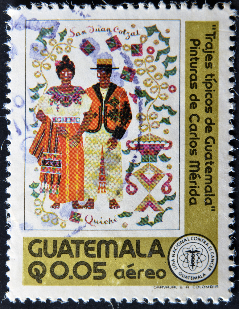 Slide 3 of 70: A stamp printed in Guatemala shows typical costumes of Guatemala, circa 1970
