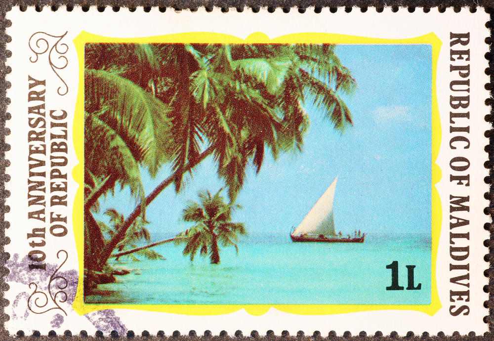Slide 62 of 70: Milan, Italy - February 24, 2017: Enchanting nature of Maldives on postage stamp