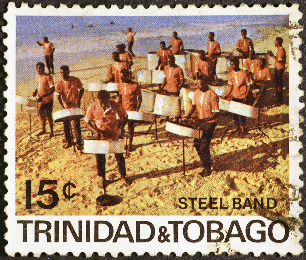 Slide 10 of 70: Milan, Italy - July 21, 2016: Steel band playing on the seaside in a postage stamp of Trinidad & Tobago