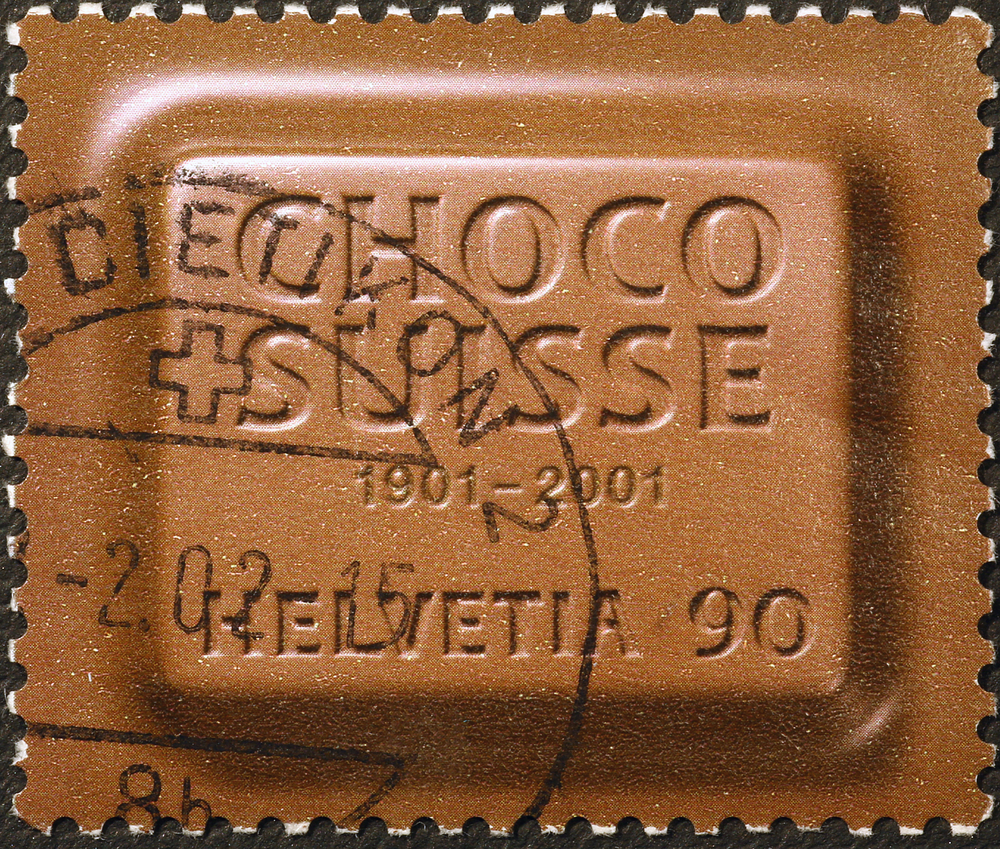 Slide 18 of 70: Milan, Italy - June 18, 2015: Swiss postage stamp imitating a piece of chocolate