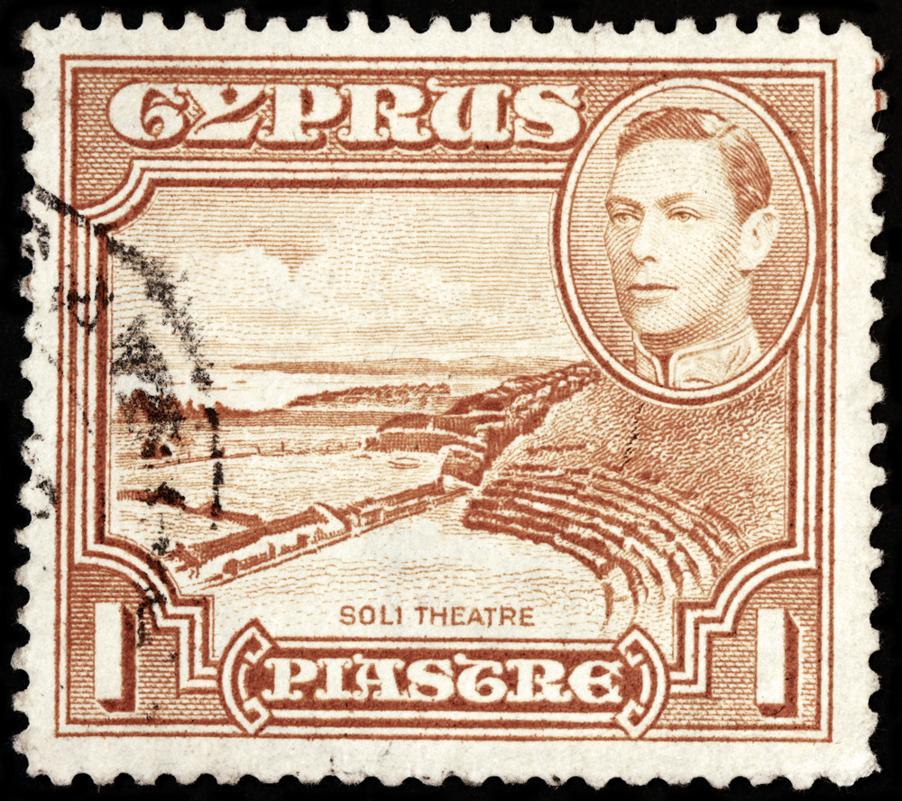Slide 65 of 70: LUGA, RUSSIA - OCTOBER 17, 2017: A stamp printed by CYPRUS shows portrait of King George VI and view of Soli Theater. Soli or Soloi is an ancient Greek city in the island of Cyprus, circa 1938