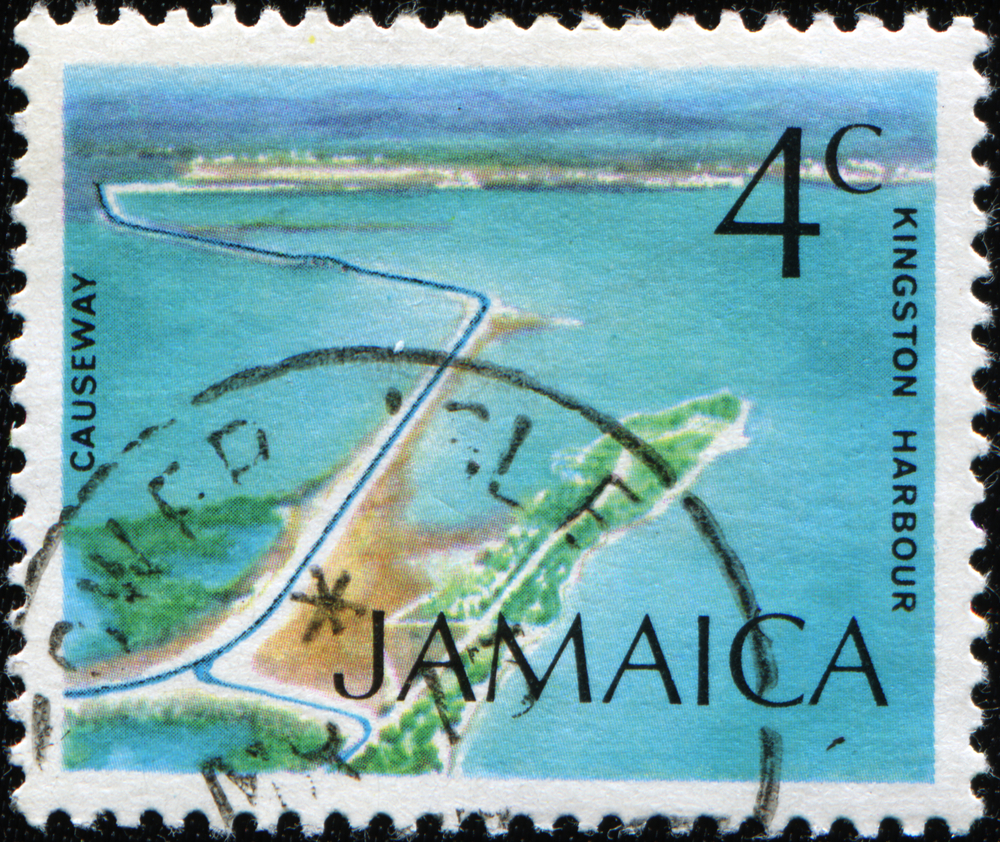Slide 7 of 70: A stamp printed in JAMAICA shows Causeway, Kingston Harbor, circa 1972