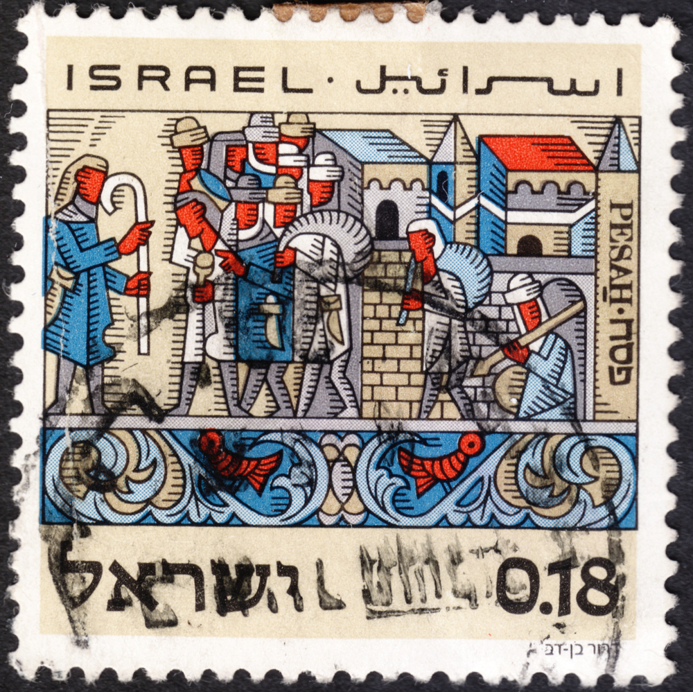 """Slide 32 of 70: MOSCOW, RUSSIA - JANUARY, 2016: a post stamp printed in ISRAEL shows feast of Passover , the exodus from Egypt, the series """"Passover Feast (Pesah)"""", circa 1972"""