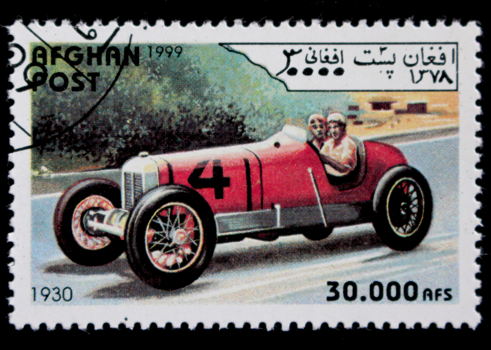 Slide 55 of 70: AFGHANISTAN - CIRCA 1999: A postage stamp printed in Afghanistan showing an image of race car, circa 1999
