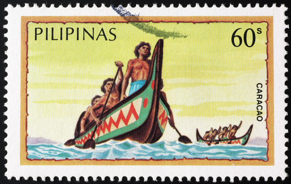 Slide 64 of 70: Milan, Italy - May 14, 2017: Traditional boats of Philippines on postage stamp